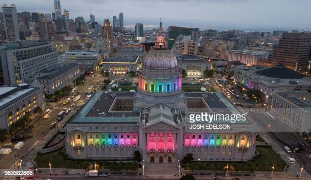 This photo taken by drone shows San Francisco City Hall lit up in rainbow colors following the Pride parade in San Francisco California on Sunday...