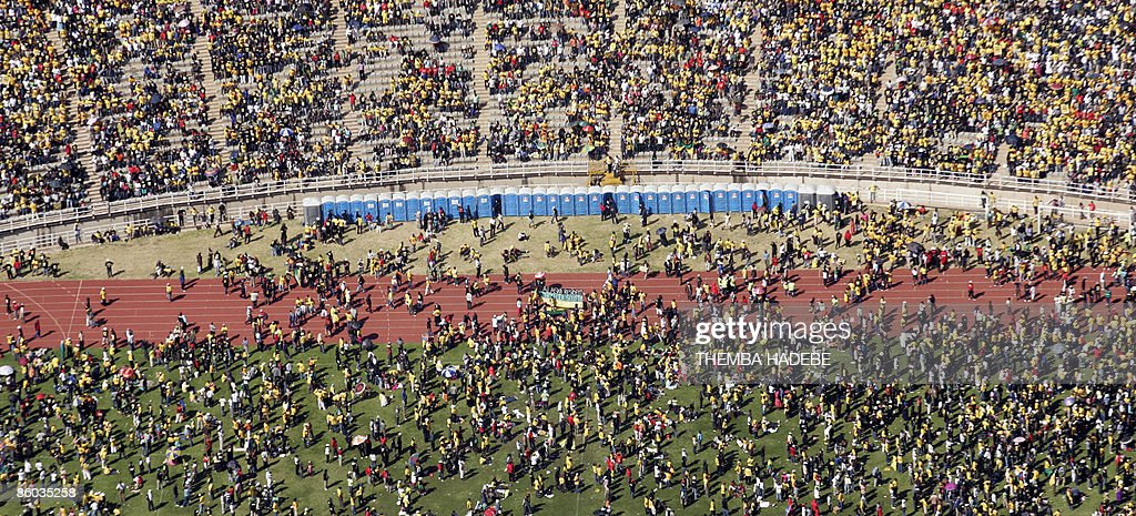 An aerial photo shows supporters of the ruling party African National Congress (ANC) during the final election rally at the Ellis Park stadium, in Johannesburg on April 19, 2009. Nelson Mandela made a surprise appearance today drawing wild cheers from a throng of 100,000 people. After 15 years of democracy, the ANC is still the party of choice for the country's mainly black and poor majority who feel populist presidential candidate Zuma will address the challenges facing them. AFP PHOTO/POOL/Themba Hadebe