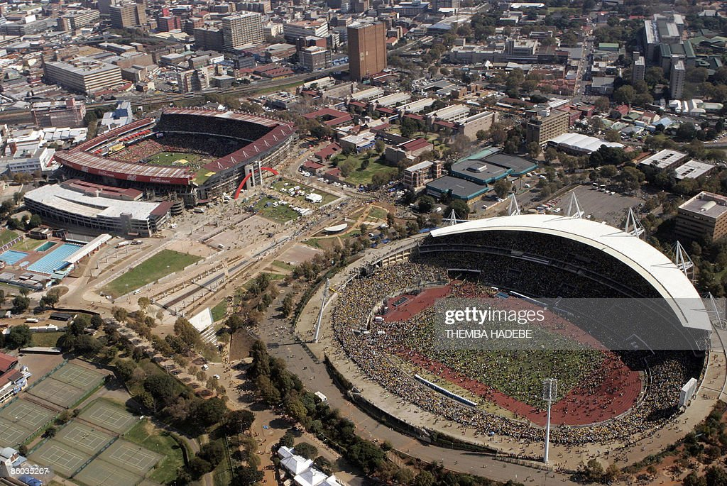 An aerial photo shows supporters of the ruling party African National Congress (ANC) during for the final election rally at the Ellis Park stadium, (top left) and Johannesburg stadium, (bottom right) on April 19, 2009. In a sea of black and gold, more than 100,000 ANC supporters today feted an anticipated victory in Wednesday's South African elections, electrified by the presence of Nelson Mandela and Jacob Zuma AFP PHOTO/POOL/Themba Hadebe-POOL