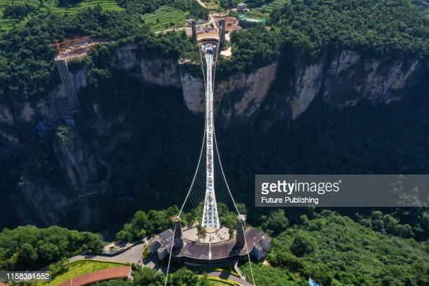 An aerial photo shows the zhangjiajie grand canyon glass bridge, the world's highest pedestrian bridge, in zhangjiajie, hunan province, China, July...