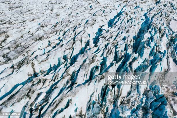 An aerial photo taken on August 17 2019 shows a view of the Apusiajik glacier near Kulusuk a settlement in the Sermersooq municipality located on the...