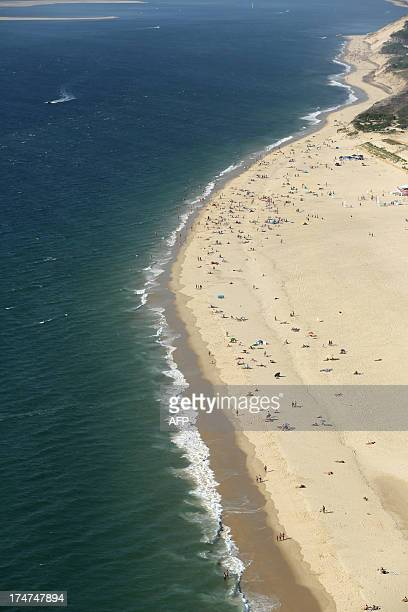 An aerial photo taken on July 26 2013 shows people on the beach along the Arcachon Basin on the French southwestern Atlantic Coast AFP PHOTO/ NICOLAS...