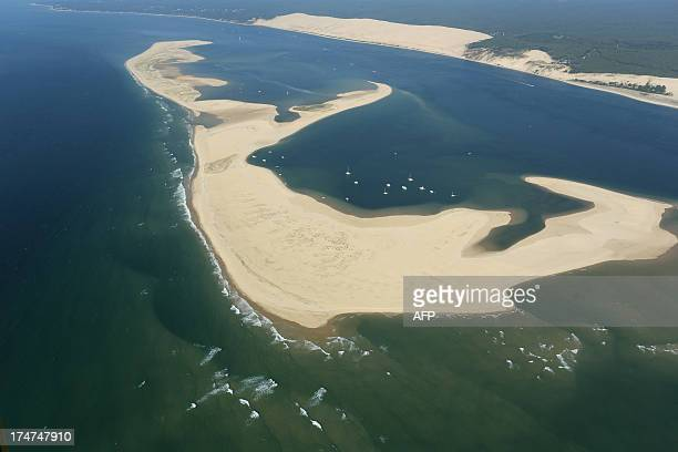 An aerial photo taken on July 26 2013 shows the Bench of Arguin in the Arcachon Basin on the French southwestern Atlantic Coast In the background the...