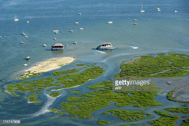 An aerial photo taken on July 26 2013 shows the Bird island with water bungalows on the Arcachon Basin on the French southwestern Atlantic Coast AFP...