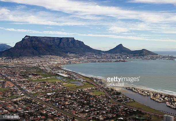 An aerial photo taken on June 30 2013 shows Table Mountain and central Cape Town in South Africa AFP PHOTO / Saul LOEB