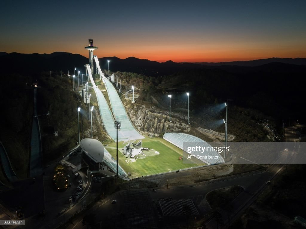TOPSHOT - An aerial photo taken on October 30, 2017 shows a general view of the ski jumping venue of the Pyeongchang 2018 Winter Olympic games, at the Alpensia resort in Pyeongchang. / AFP PHOTO / Ed JONES