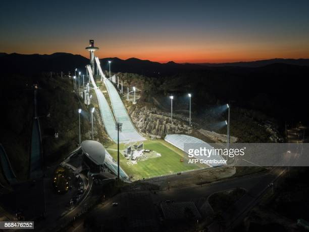 TOPSHOT An aerial photo taken on October 30 2017 shows a general view of the ski jumping venue of the Pyeongchang 2018 Winter Olympic games at the...