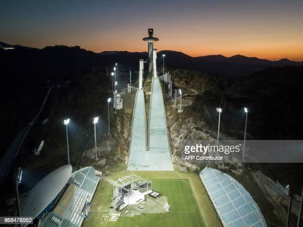 An aerial photo taken on October 30 2017 shows a general view of the ski jumping venue of the Pyeongchang 2018 Winter Olympic games at the Alpensia...