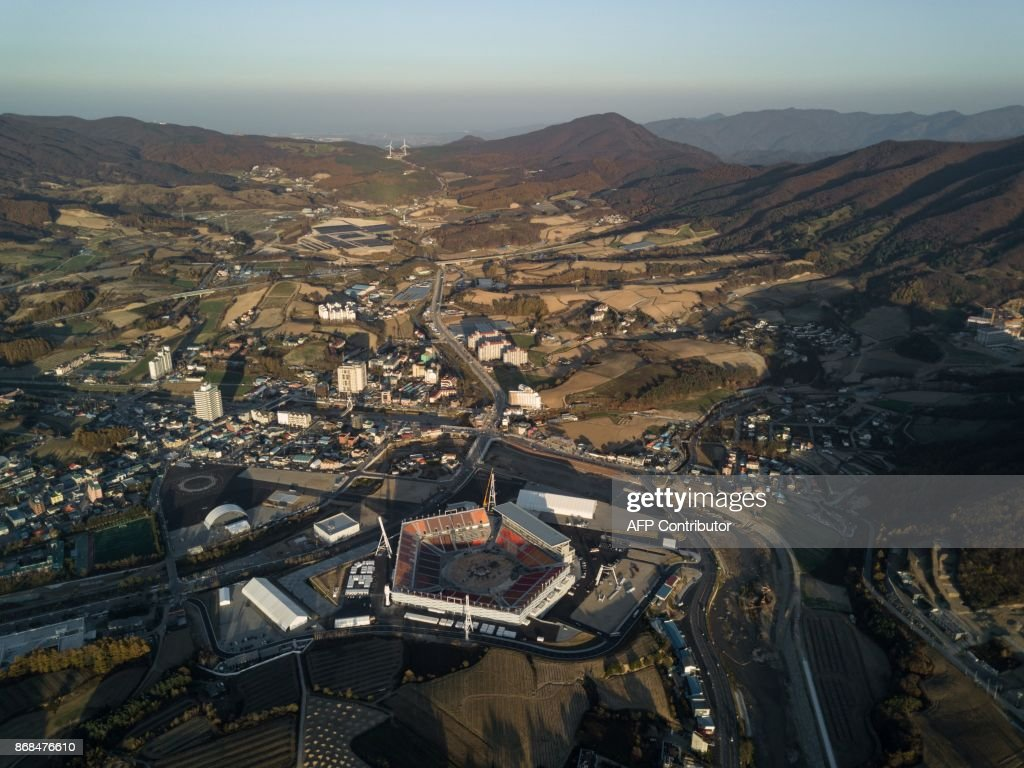 An aerial photo taken on October 30, 2017 shows a general view of the Pyeongchang Olympic Stadium venue of the Pyeongchang 2018 Winter Olympic games, in the town of Hoenggye. / AFP PHOTO / Ed JONES