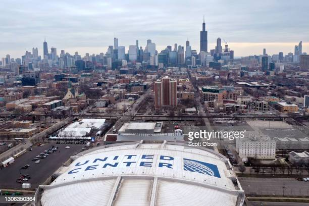 An aerial photo taken with a drone shows a group of white tents, constructed in a parking lot at the United Center, home to the Chicago Bulls and...