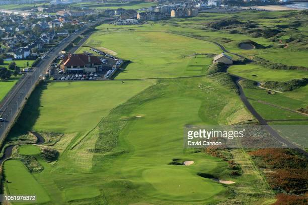 An aerial photograph from behind the green looking back to the clubhouse on the par 4 first hole 'Hughie's' on the Dunluce Links at Royal Portrush...