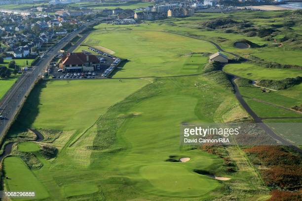 An aerial photograph from behind the green looking back to the clubhouse on the par 4, first hole 'Hughie's' on the Dunluce Links at Royal Portrush...