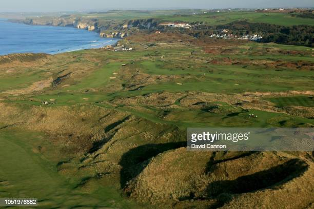 An aerial photograph from behind the green looking back to the tee on the par 3, 16th hole 'Calamity Corner' on the Dunluce Links at Royal Portrush...