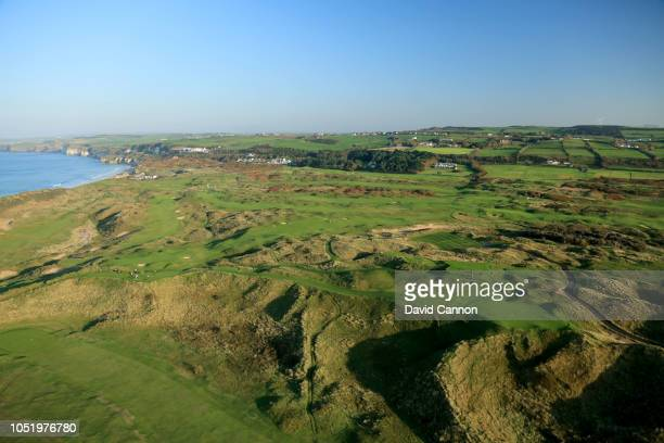 An aerial photograph from behind the green looking back to the tee on the par 3 16th hole 'Calamity Corner' on the Dunluce Links at Royal Portrush...