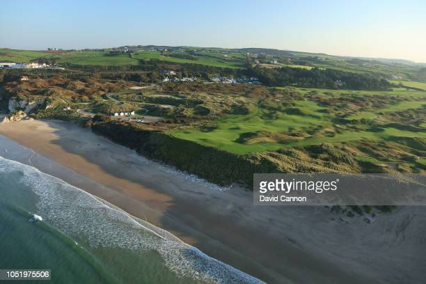 An aerial photograph from out to sea of the par 3, sixth hole Harry Colts' to the right and the par 4, fifth hole 'White Rocks' to the left on the...