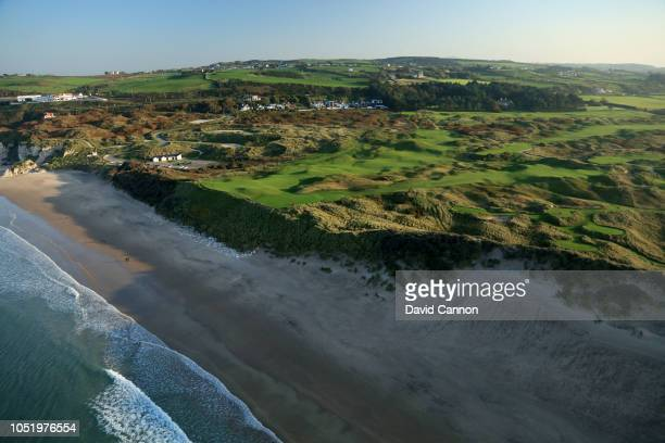 An aerial photograph from out to sea of the par 3, sixth hole Harry Colts' in the foreground and the par 4, fifth hole 'White Rocks' behind on the...