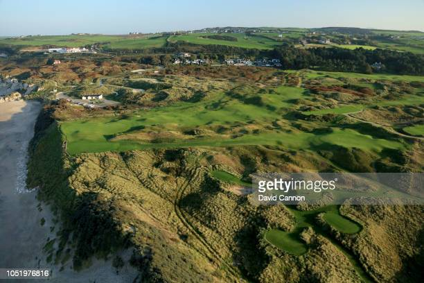 An aerial photograph from out to sea of the par 3 sixth hole Harry Colts' in the foreground and the par 4 fifth hole 'White Rocks' behind on the...