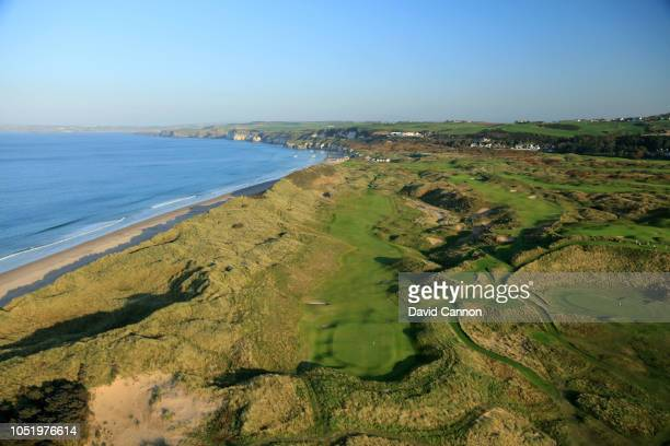 An aerial photograph looking back down the beach from behind the green on the par 5 seventh hole 'Curran Point' on the Dunluce Links at Royal...