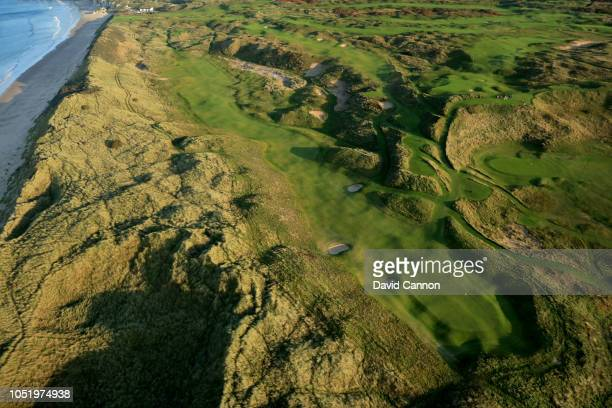 An aerial photograph looking back down the beach from the green on the par 5, seventh hole 'Curran Point' on the Dunluce Links at Royal Portrush Golf...