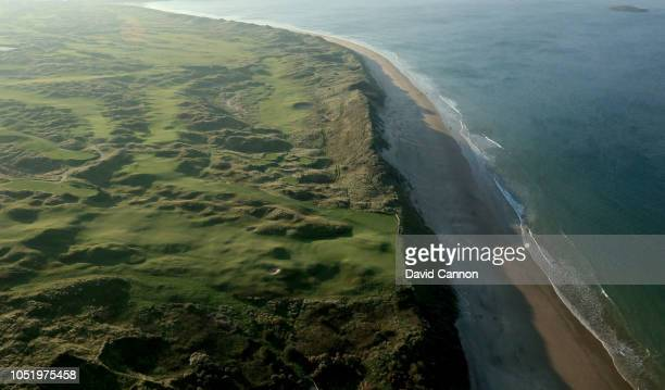 An aerial photograph looking towards the town of Portrush above the green on the par 4, fifth hole 'White Rocks' with the sixth, seventhand eighth...