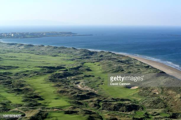 An aerial photograph looking towards the town of Portrush of the par 5 seventh hole 'Curran Point' to the right with the par 4 eighth hole 'Dunluce'...