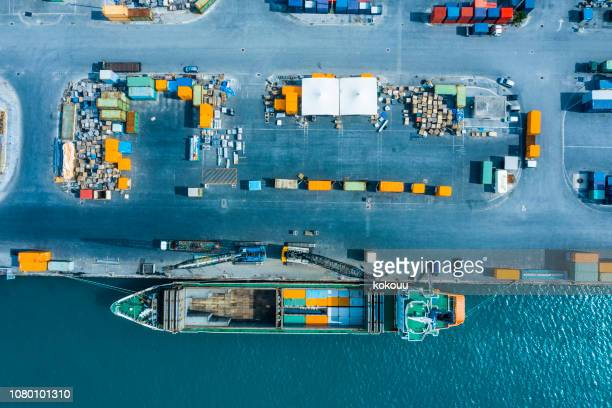 an aerial photograph of a container ship fixed at a commercial port. - japan economy stock pictures, royalty-free photos & images