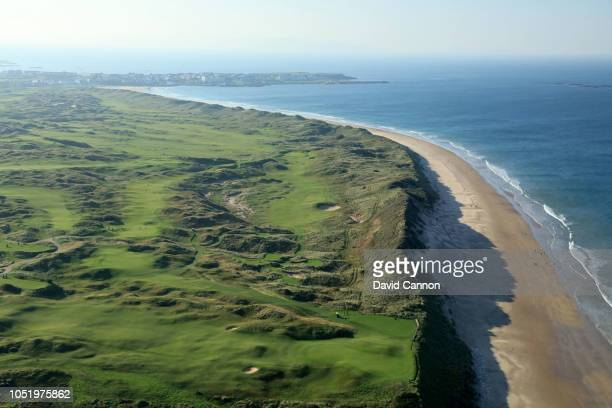 An aerial photograph of a general view from above the fifth hole with the 6th, 7th, 8th, 10th holes immediately behind and the beach running back to...