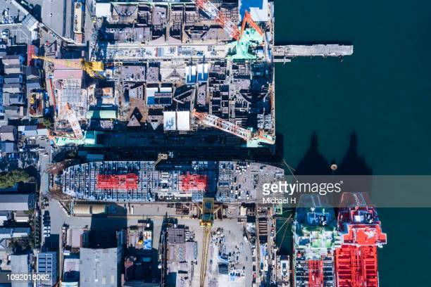 an aerial photograph of a large ship under construction at the port. - military ship stock pictures, royalty-free photos & images