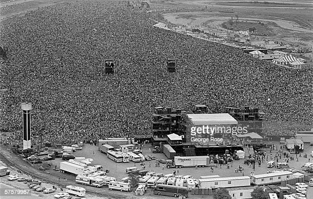 An aerial photograph of more than 300000 people jammed into the infield of Ontario California Motor Speedway to hear Ted Nugent Aerosmith and Santana...