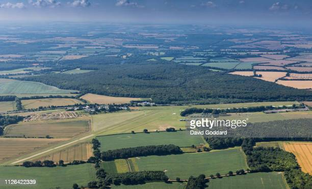 An aerial photograph of Popham Airfield, Located to the north of the A303 dual carriageway, 7 miles south west of Basingstoke. Aerial Photograph by...