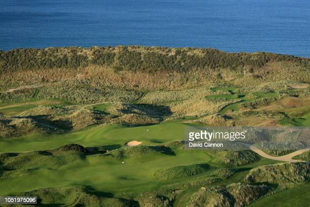 An aerial photograph of the greens on the par 4, eighth hole in the rear and the par 4, 10th hole in the foreground on the Dunluce Links at Royal...