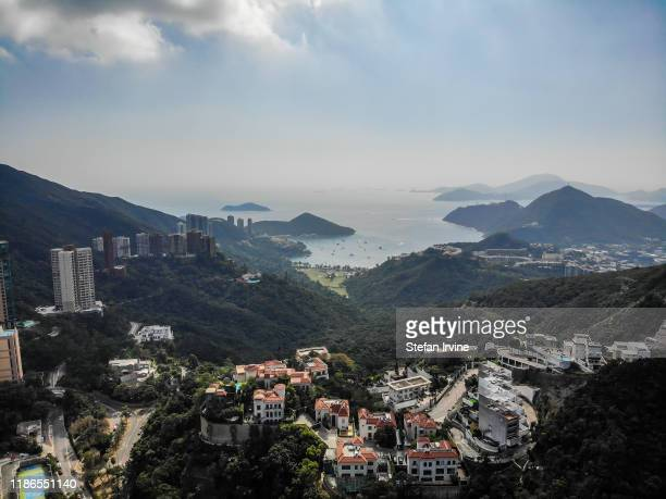 An aerial photograph taken above Happy Valley, Hong Kong, looking towards Deep Water Bay and the South China Sea.