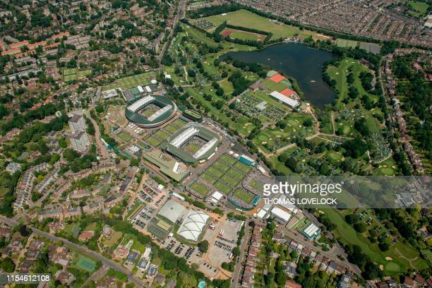 An aerial photograph taken from a helicopter shows a general view of The All England Lawn Tennis Club in Wimbledon southwest London on the fourth day...