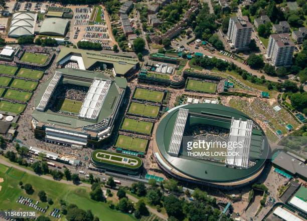 TOPSHOT An aerial photograph taken from a helicopter shows a general view of The All England Lawn Tennis Club in Wimbledon southwest London on the...