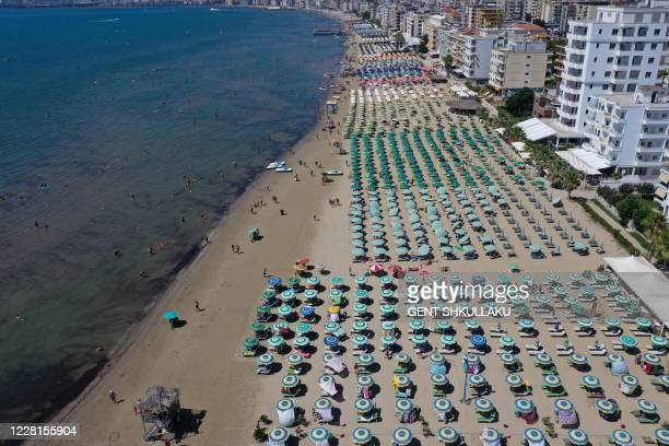 An aerial photograph taken on August 22 shows parasols on a beach of the Adriatic Sea in Durres, as a heatwave sweeps through Europe. - Due to the...
