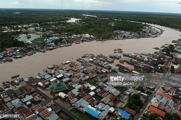 An aerial photograph taken on July 6 2010 shows a river running through Palangkaraya town in Central Kalimantan on Indonesian Borneo island The rich...