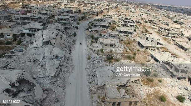 An aerial picture captured from drone video footage on September 20 2017 shows massive destruction in a rebelheld area in the southern Syrian city of...