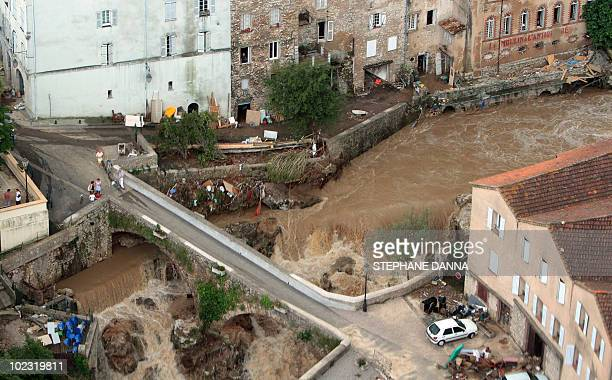 An aerial picture shows a bridge over the overflowed Nartuby river in the French southeastern city of TransenProvence on June 17 2010 in the...