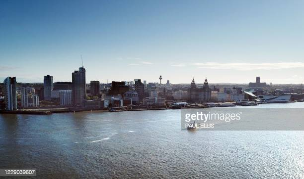 An aerial picture shows a ferry crossing the River Mersey in Liverpool, north west England on October 13 as new local lockdown measures are set to be...