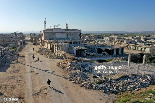 An aerial picture shows a view of damaged buildings in the abandoned village of Kafr Nuran, in the western countryside of Syria's Aleppo province,...