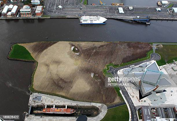 An aerial picture shows Britain and Irelands largest land art entitled 'Wish' at Belfasts Titanic Quarter in Northern Ireland on October 23 2013...