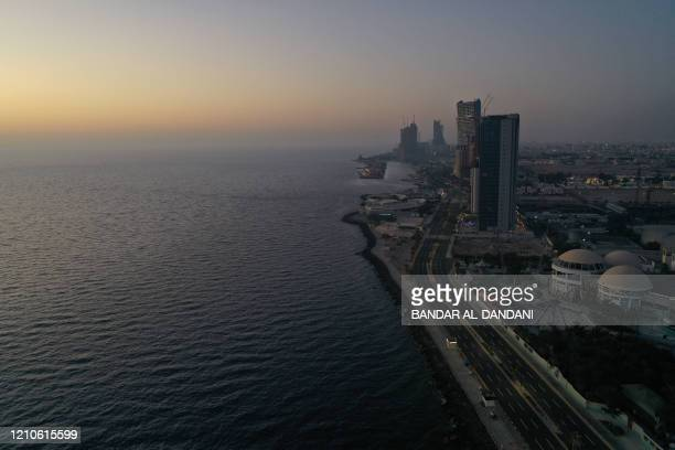 An aerial picture shows deserted streets in the Saudi coastal city of Jeddah, on April 21 during the novel coronavirus pandemic crisis.