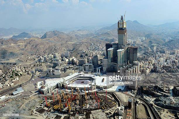 An aerial picture shows Mecca Clock Royal Tower hotel topped by the biggest clock in the world with a 45 meters diameter which overlooks the Grand...