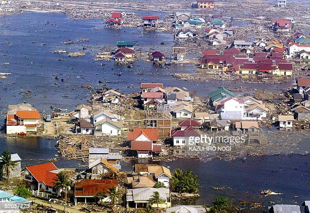 An aerial picture shows the devastated area of Banda Aceh following the tsunami disasters 20 January 2005 Indonesia's official death toll from last...