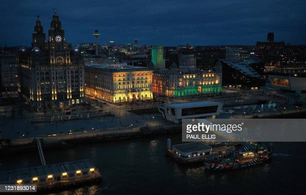 An aerial picture shows The Liver Building , The Cunard Building and the Port of Liverpool building illuminated as part of the National Day of...
