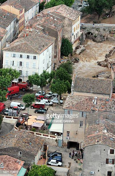An aerial picture shows the overflowed Nartuby river in the French southeastern city of TransenProvence on June 17 2010 in the aftermath of floods...