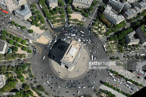 An aerial picture taken aboard an helicopter on July 20 2010 shows a view of the Arc de triomphe in Paris AFP PHOTO BORIS HORVAT