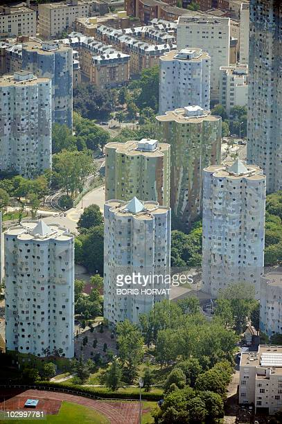 An aerial picture taken aboard an helicopter on July 20, 2010 shows buildings in Nanterre behind on the esplanade of La Defense, Paris's major...