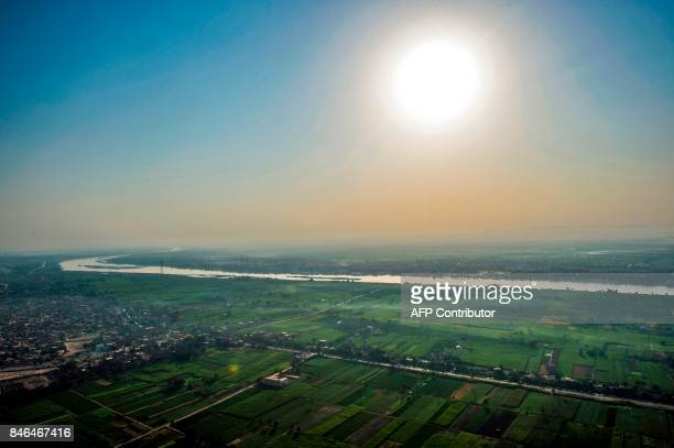 An aerial picture taken from a hot air balloon on September 10 2017 shows a view of the Nile as it flows through the farmland countryside around the...