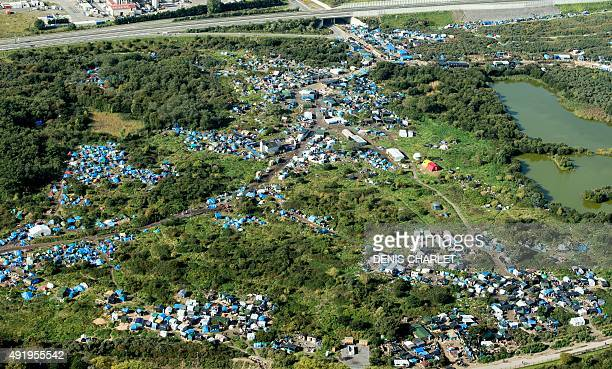 An aerial picture taken in Calais on October 9 2015 shows a site dubbed the New Jungle where some 3000 people have set up camp most seeking...